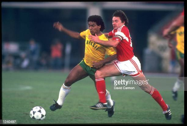 ROMARIO OF BRAZIL IS CHALLENGED BY YURI SAVICHEV OF THE SOVIET UNION DURING THE FINAL OF THE SOCCER TOURNAMENT AT THE 1988 SEOUL OLYMPICS THE SOVIET...
