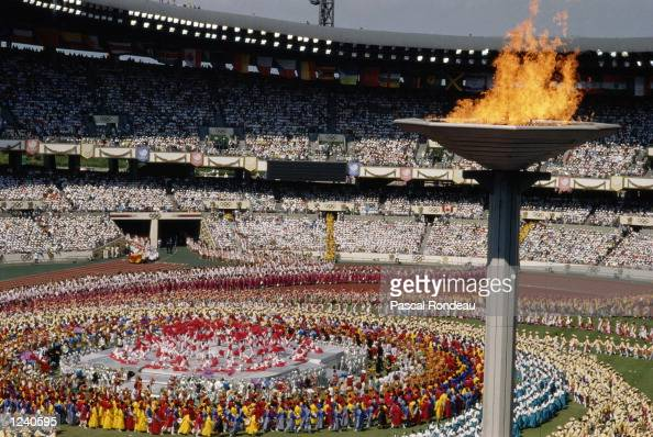 DANCERS PERFORM IN THE CENTRE OF THE STADIUM DURING THE OPENING CEREMONY OF THE 1988 SUMMER OLYMPICS HELD IN SEOUL IN SOUTH KOREA