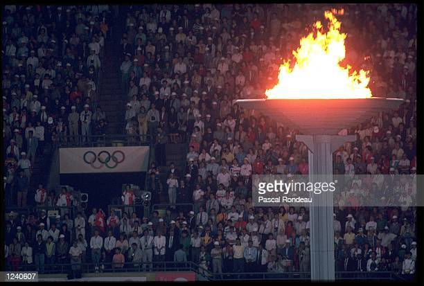 THE OLYMPIC FLAME CONTINUES TO BURN DURING THE CLOSING CEREMONY OF THE 1988 SUMMER OLYMPICS HELD IN SEOUL IN SOUTH KOREA