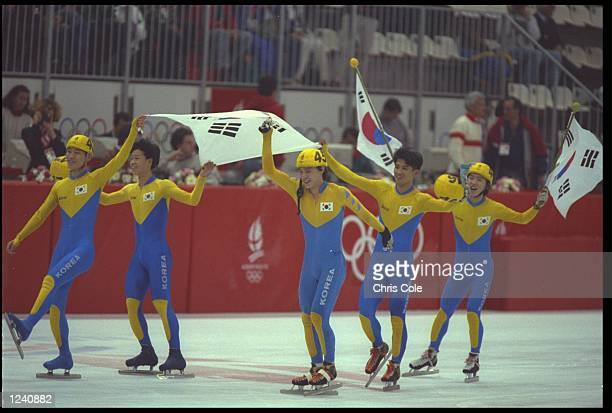 THE MENS 5000 METRE SHORT TRACK SPEED SKATING RELAY TEAM FROM KOREA CELEBRATE AFTER WINNING THE WINNING THE GOLD MEDAL AT THE 1992 WINTER OLYMPICS IN...