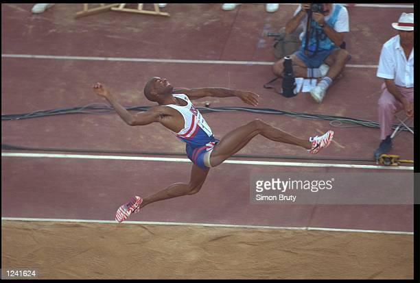 MIKE POWELL OF THE UNITED STATES SAILS THROUGH THE AIR AS HE ATTEMPTS A JUMP DURING THE MENS LONG JUMP COMPETITION AT THE 1992 BARCELONA OLYMPICS...