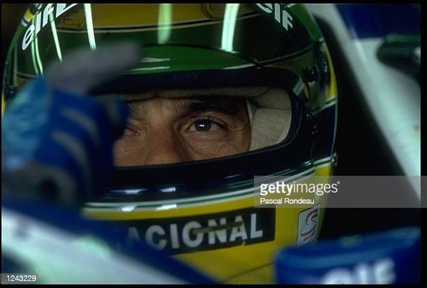 ARYTON SENNA OF BRAZIL SITS IN HIS WILLIAMS RENAULT IN THE PITS WHILE HIS CAR IS PREPARED FOR THE SAN MARINO GRAND PRIX IMOLA MICHAEL SCHUMACHER WON...