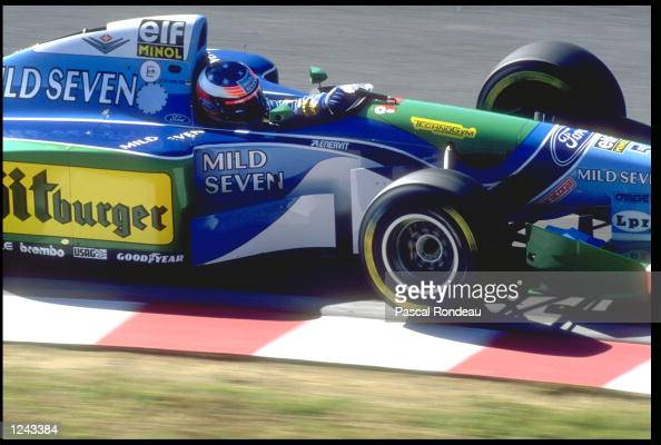 MICHAEL SCHUMACHER OF GERMANY RIDES THE KERB IN HIS BENETTON FORD COSWORTH DURING THE JAPANESE GRAND PRIX IN SUZUKA DAMON HILL WON THE RACE WITH...
