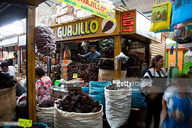 CHILLI SELLER IN CLOSED MARKET IN OAXACA MEXICO