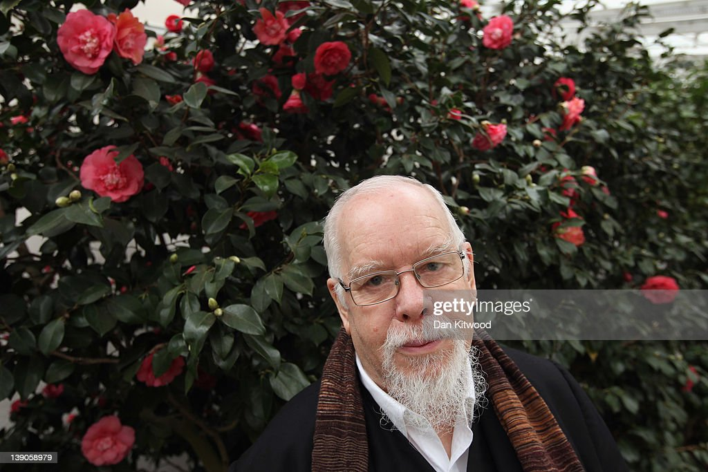 Artist Sir Peter Blake poses for a photograph while attending the opening of Chiswick House Camellia Festival on on February 16 2012 in Chiswick...