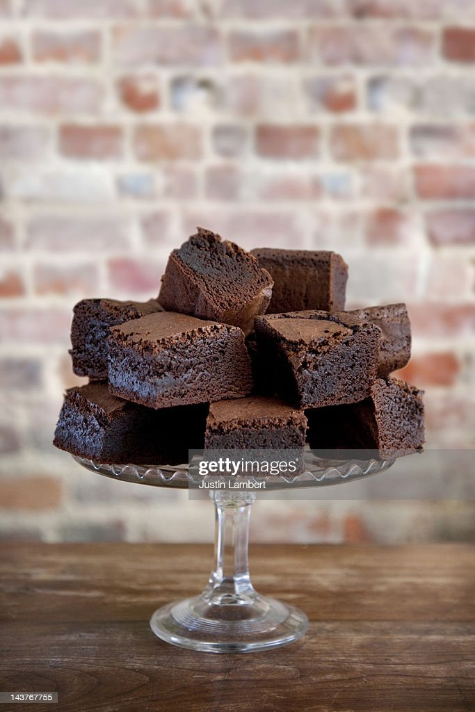 PILE OF CHOCOLATE BROWNIES ON CAKE STAND