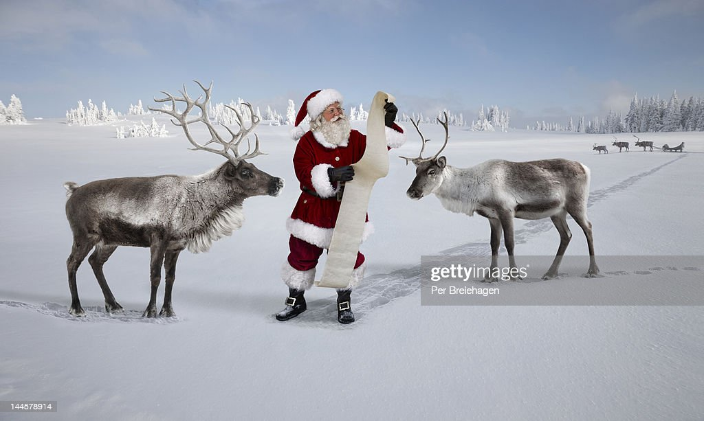 SANTA CLAUSE AND THE CHRISTMAS WISH LIST : Stock Photo