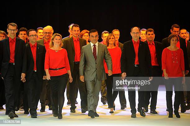 Carlos Ghosn chief executive officer of Nissan Motor Co and Renault SA arrives on stage wtih employees for a news conference for the presentation of...