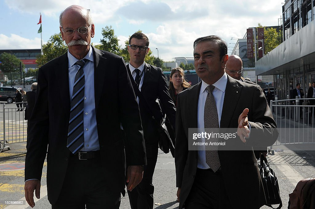 Dieter Zetsche, chief executive officer of Daimler AG, left, speaks with Carlos Ghosn, chief executive officer of Renault SA and Nissan Motor Co., at the Paris Motor Show on September 28, 2012 in Paris, France. The Paris Motor Show runs September 29 - October 14.