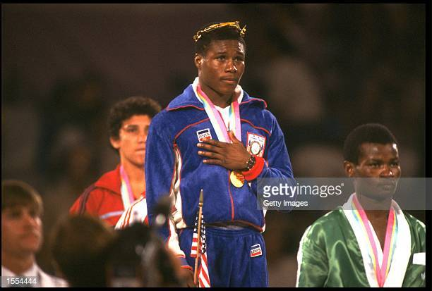 MELDRICK TAYLOR OF THE UNITED STATES LISTENS TO THE NATIONAL ANTHEM AFTER RECEIVING THE GOLD MEDAL IN THE 57KG FEATHERWEIGHT BOXING COMPETITION AT...