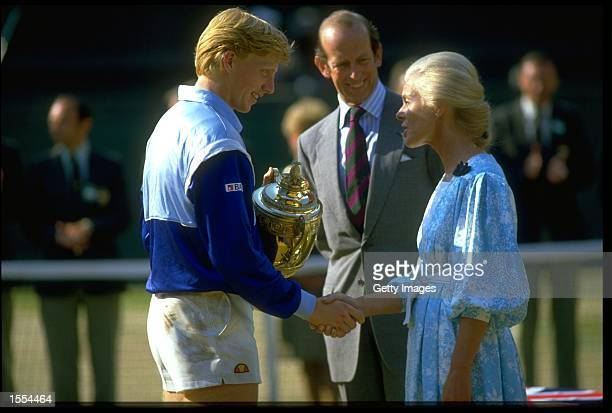 BORIS BECKER OF WEST GERMANY RECEIVES THE TROPHY AFTER WINNING THE 1985 WIMBLEDON TENNIS CHAMPIONSHIPS BECKER DEFEATED KEVIN CURREN 63 67 76 64 TO...