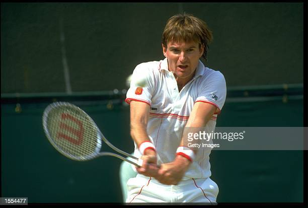 JIMMY CONNORS OF THE UNITED STATES PREPARES TO PLAY A BACKHAND STROKE DURING A MATCH AT THE 1985 WIMBLEDON TENNIS CHAMPIONSHIPS