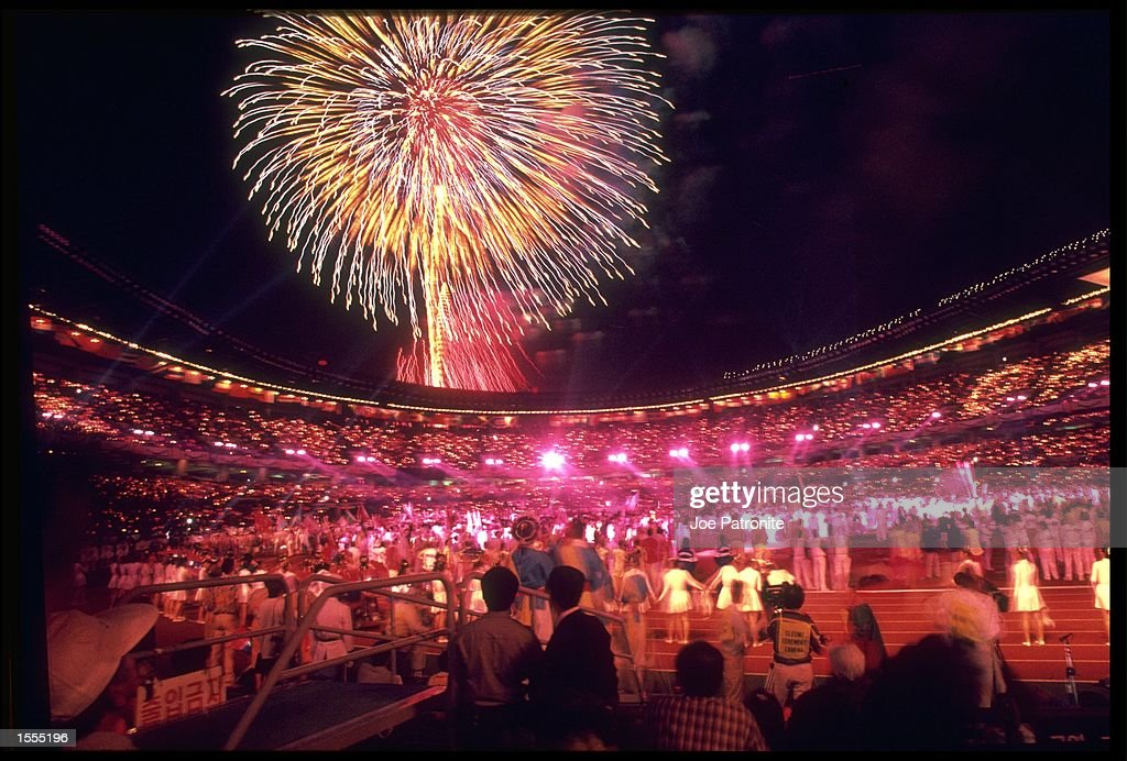 FIREWORKS EXPLODE ABOVE THE STADIUM DURING THE FINALE OF THE CLOSING CEREMONY OF THE 1988 SEOUL OLYMPICS.
