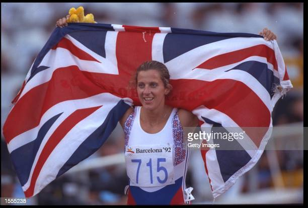 SALLY GUNNELL OF GREAT BRITAIN HOLDS THE FLAG OVER HER SHOULDERS AFTER CLAIMING VICTORY IN THE WOMENS 400 METRE HURDLE EVENT AT THE 1992 BARCELONA...