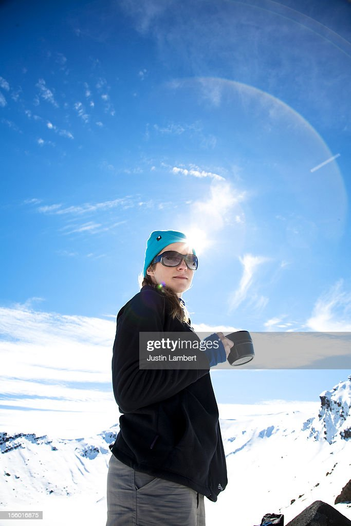GIRL DRINKING A CUP OF TEA IN THE MOUTAINS : Stock Photo