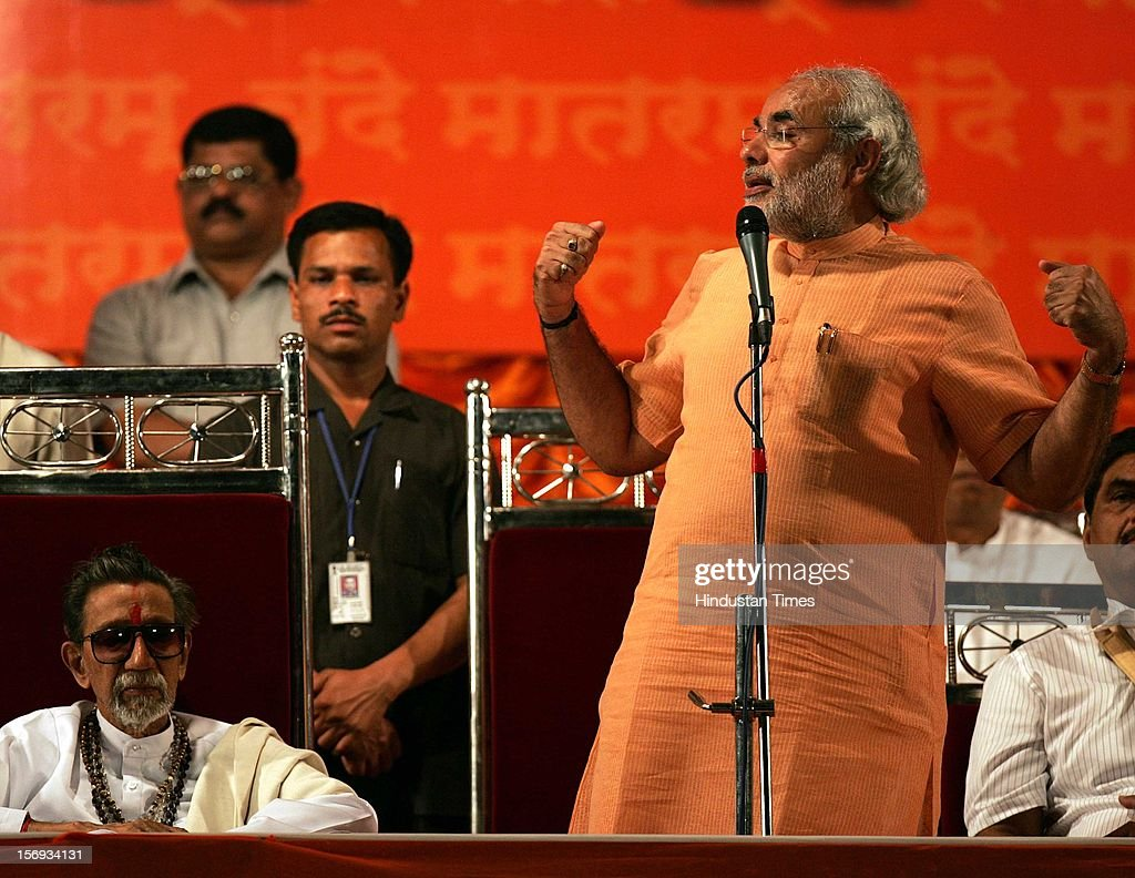 NARENDRA MODI MAKES A GESTURE AS SHIVSENA SUPREMO BALASAHEB THACKERAY LOOKS ON DURING THE SHIV SENA-BJP RALLY AT SHIVAJI PARK ON JANUARY 28, 2007 IN MUMBAI, INDIA.