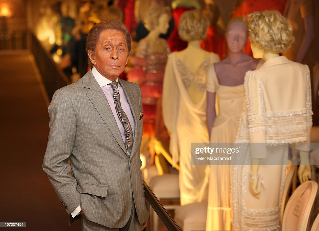 Fashion designer Valentino Garavani poses beside exhibits during a press preview of the 'Valentino: Master of Couture' exhibition at Somerset House on November 28, 2012 in London, United Kingdom. Celebrating the life and work of the Italian master couturier, the show features over 130 hand crafted designs worn by Hollywood icons and Royalty. The exhibition runs from November 29, 2012 - March 3, 2013.