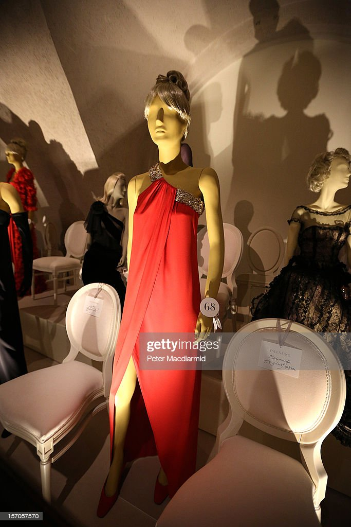 A red crape evening dress from the Autumn/Winter 1967/68 collection is shown in a catwalk display at the 'Valentino: Master of Couture' exhibition at Somerset House on November 28, 2012 in London, United Kingdom. Celebrating the life and work of the Italian master couturier, the show features over 130 hand crafted designs worn by Hollywood icons and Royalty. The exhibition runs from November 29, 2012 - March 3, 2013.