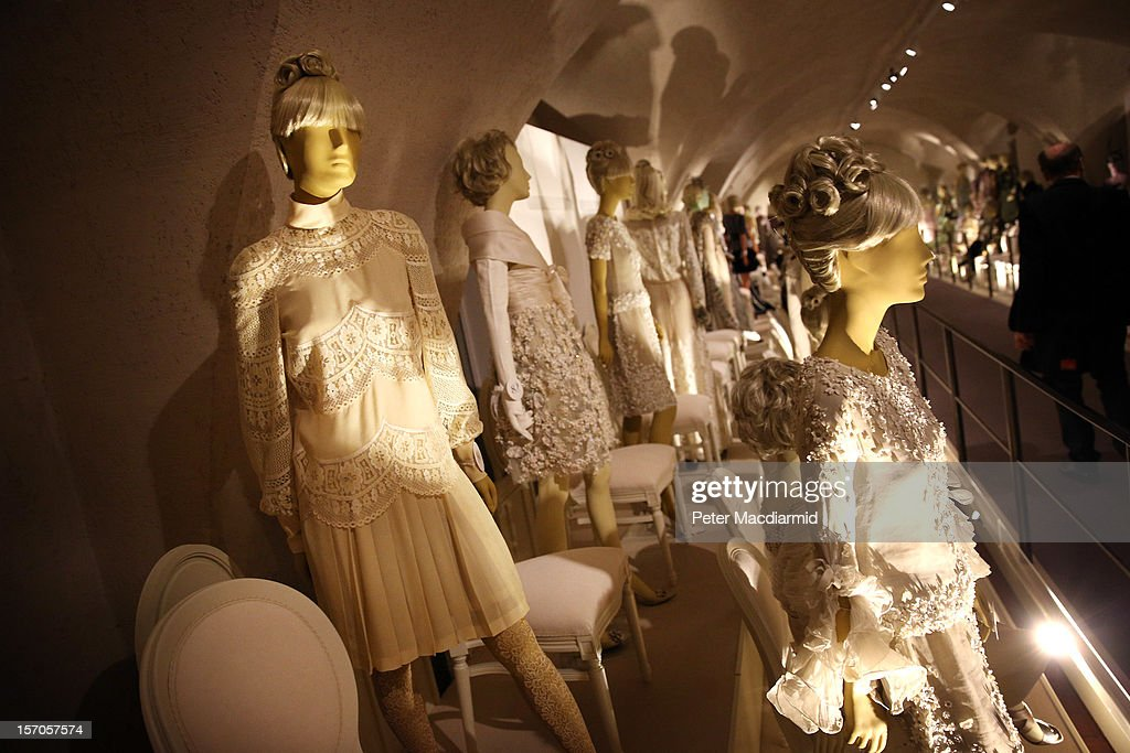 A wedding dress belonging to Jackie Onassis (L) from 1968 is shown in a catwalk display at the 'Valentino: Master of Couture' exhibition at Somerset House on November 28, 2012 in London, United Kingdom. Celebrating the life and work of the Italian master couturier, the show features over 130 hand crafted designs worn by Hollywood icons and Royalty. The exhibition runs from November 29, 2012 - March 3, 2013.