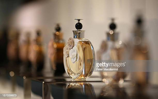 Perfume bottles line a shelf in the gallery shop at the 'Valentino Master of Couture' exhibition at Somerset House on November 28 2012 in London...