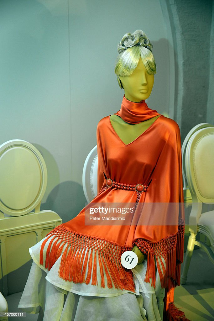 An orange satin poncho form 1969 worn by Grace Kelly is displayed at the 'Valentino: Master of Couture' exhibition at Somerset House on November 28, 2012 in London, United Kingdom. Celebrating the life and work of the Italian master couturier, the show features over 130 hand crafted designs worn by Hollywood icons and Royalty. The exhibition runs from November 29, 2012 - March 3, 2013.