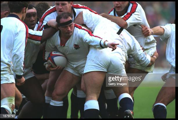 BRIAN MOORE OF ENGLAND POINTS AS HE IS PROTECTED BY TEAMMATES DURING THE ENGLAND V NEW ZEALAND MATCH PLAYED AT TWICKENHAM ENGLAND WON THE MATCH 159
