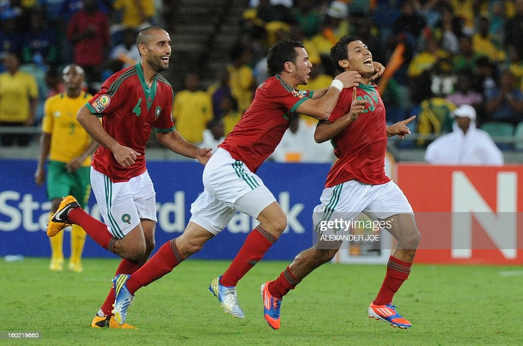 Morocco's Abdelilah Hafidi (R) is congratulated by teammates after scoring a goal during the 2013 African Cup of Nations football match in Durban on January 27, 2013 in Durban at Moses Mabhida Stadium for a Group A match. The African Cup of Nations is been held in South Africa from January 19 - February 10.