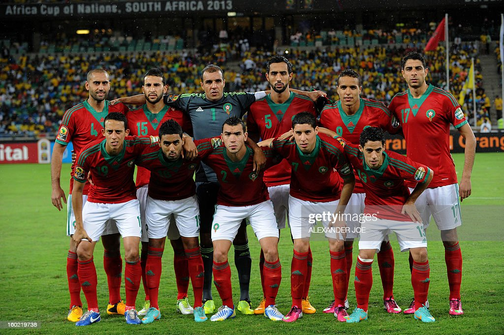 Morocco's squad line up prior to the 2013 African Cup of Nations football match in Durban on January 27, 2013 in Durban at Moses Mabhida Stadium for a Group A match. Front row L-R : Forward Yacine Bezzaz, Midfielder Khaled Lemmouchia, Defender Mehdi Mostefa, Midfielder Ryad Boudebouz , Forward Mohamed Amine Aoudia. Back row R-L: Defender Essaid Belkalem, Forward Hilal Soudani, Goalkeeper Azzeddine Doukha, Defender Rafik Halliche, Forward Islam Slimani and Algria Midfielder Adlene Guedioura. The African Cup of Nations is been held in South Africa from January 19 - February 10.