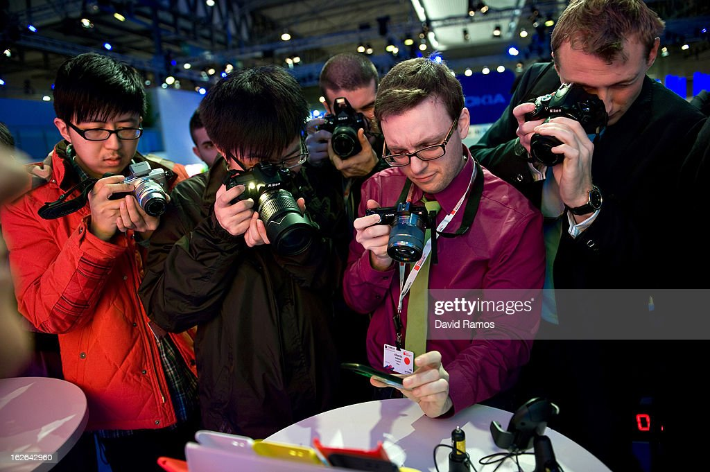 Visitors take pictures of a new Nokia device during the first day of the Mobile World Congress 2013 at the Fira Gran Via complex on February 25, 2013 in Barcelona, Spain. The annual Mobile World Congress hosts some of the world's largest communication companies, with many unveiling their latest phones and gadgets. The show runs from February 25 - February 28.
