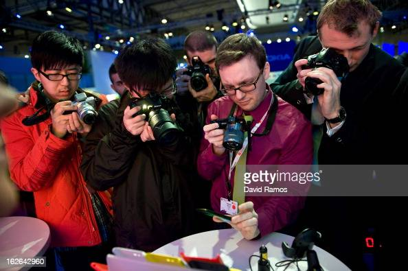Visitors take pictures of a new Nokia device during the first day of the Mobile World Congress 2013 at the Fira Gran Via complex on February 25 2013...