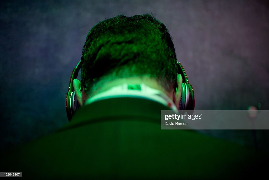 A visitor listens to music with headphones as he tests a new HTC device during the first day of the Mobile World Congress 2013 at the Fira Gran Via complex on February 25, 2013 in Barcelona, Spain. The annual Mobile World Congress hosts some of the world's largest communication companies, with many unveiling their latest phones and gadgets. The show runs from February 25 - February 28.