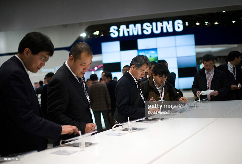Visitors look at new Samsung devices during the first day of the Mobile World Congress 2013 at the Fira Gran Via complex on February 25, 2013 in Barcelona, Spain. The annual Mobile World Congress hosts some of the world's largest communication companies, with many unveiling their latest phones and gadgets. The show runs from February 25 - February 28.