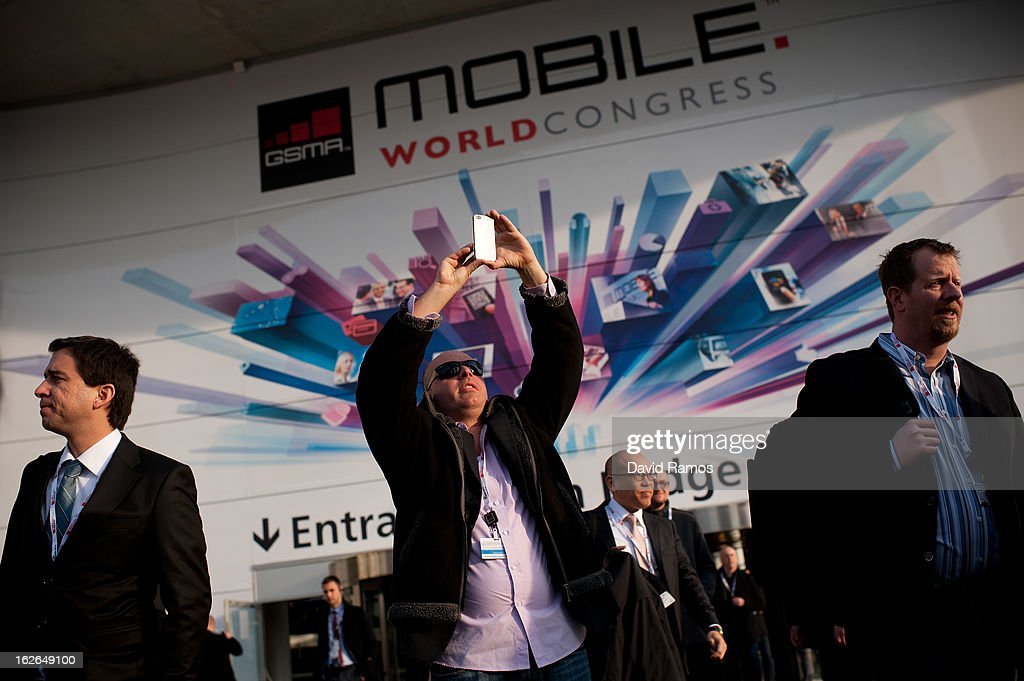 A visitor takes a picture with his mobile phone at the end of the first day of the Mobile World Congress 2013 at the Fira Gran Via complex on February 25, 2013 in Barcelona, Spain. The annual Mobile World Congress hosts some of the world's largest communication companies, with many unveiling their latest phones and gadgets. The show runs from February 25 - February 28.