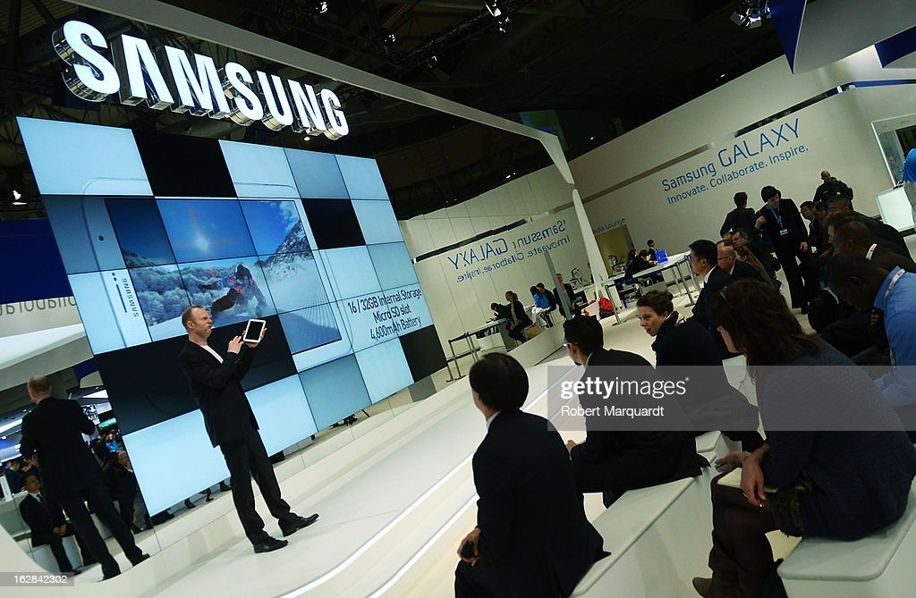 Visitors watch a product demonstration at the Samsung stand on February 28, 2013 in Barcelona, Spain. The annual Mobile World Congress hosts some of the world's largest communication companies, with many unveiling their latest phones and gadgets. The show runs from February 25 - February 28.