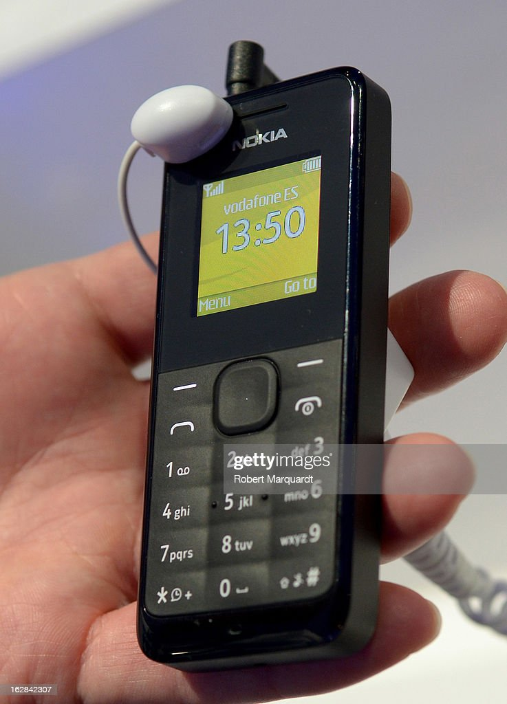 A visitor holds a Nokia 105 mobile phone at the Nokia stand on February 28, 2013 in Barcelona, Spain. The annual Mobile World Congress hosts some of the world's largest communication companies, with many unveiling their latest phones and gadgets. The show runs from February 25 - February 28.