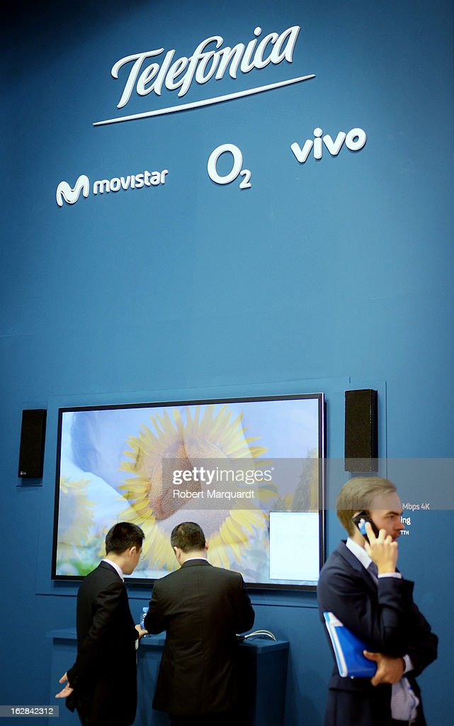 Visitors look at products at the Telefonica stand on February 28, 2013 in Barcelona, Spain. The annual Mobile World Congress hosts some of the world's largest communication companies, with many unveiling their latest phones and gadgets. The show runs from February 25 - February 28.