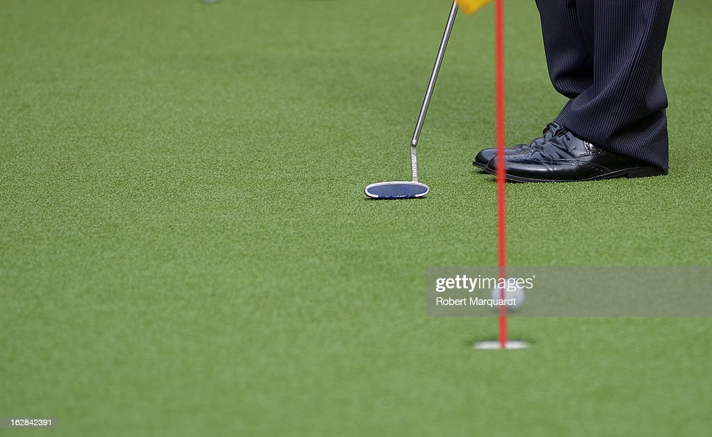 A visitor putts on the putting green garden on February 28, 2013 in Barcelona, Spain. The annual Mobile World Congress hosts some of the world's largest communication companies, with many unveiling their latest phones and gadgets. The show runs from February 25 - February 28.