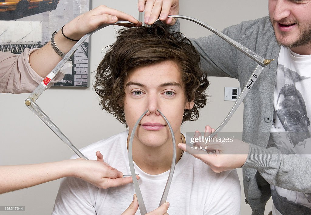 In this handout image provided by Madame Tussauds, Harry Styles of One Direction poses with calipers during a figure sitting where he is measured for a wax figure creation. Madame Tussauds announced March 11, 2013 that the world famous wax attraction will immortalize the band by creating five individual wax figures of each member. The figures are being created in full cooperation with the band and will be part of a traveling exhibit that will launch in London on April 18 before traveling to New York, July 19 - October 11, and Sydney, October 24 - January 28.