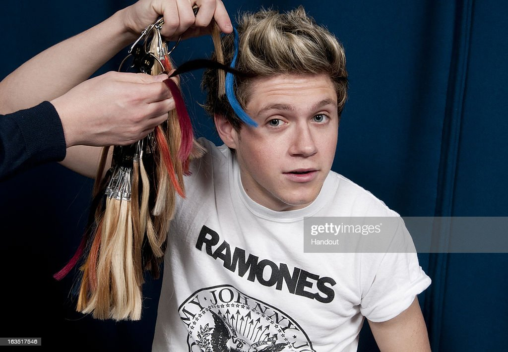 In this handout image provided by Madame Tussauds, Niall Horan of One Direction poses with hair samples during a figure sitting where he is measured for a wax figure creation. Madame Tussauds announced March 11, 2013 that the world famous wax attraction will immortalize the band by creating five individual wax figures of each member. The figures are being created in full cooperation with the band and will be part of a traveling exhibit that will launch in London on April 18 before traveling to New York, July 19 - October 11, and Sydney, October 24 - January 28.