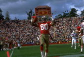 SAN FRANCISCO 49ERS WIDE RECEIVER JERRY RICE CELEBRATES AFTER SCORING A TOUCHDOWN DURING THE 49ERS 3720 WIN OVER THE NEW ENGLAND PATRIOTS AT STANFORD...