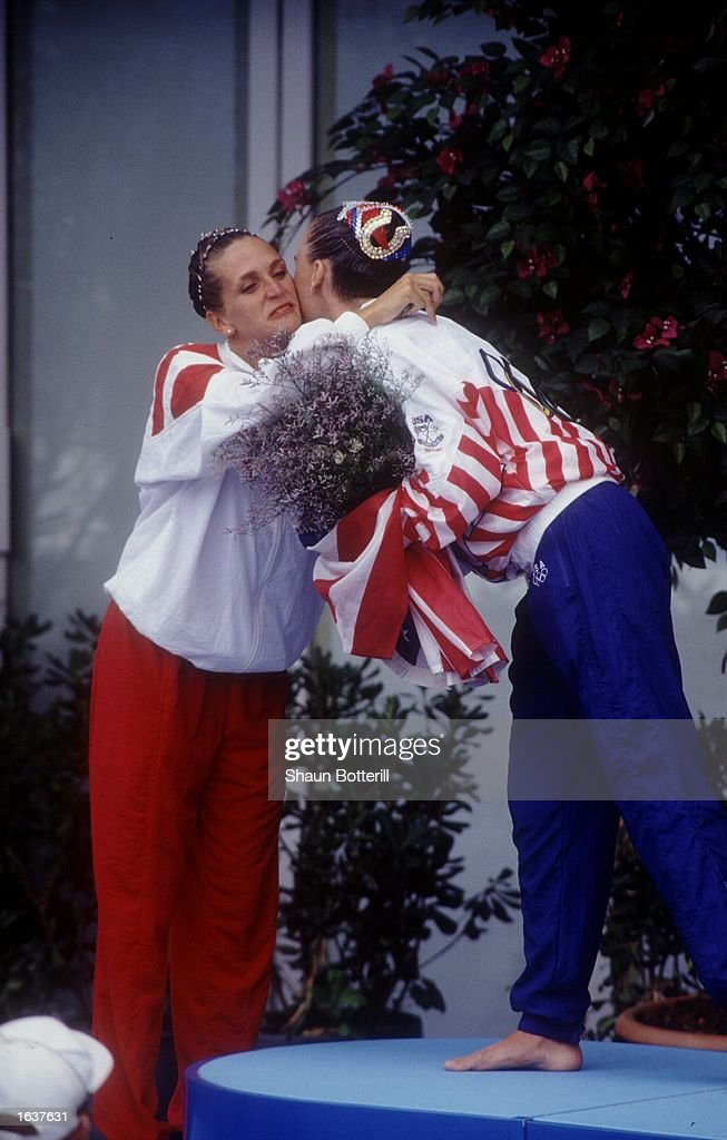 SYLVIE FRECHETTE (CAN) HUGS KRISTIN BABB-SPRAGUE (USA) AFTER RECEIVING THE SILVER MEDAL IN SOLO SYNCHRONIZED SWIIMMING DURING THE 1992 SUMMER OLYMPICS IN BARCELONA, SPAIN. THE MEDAL WAS A CONTROVERSIAL ONE DUE TO A SCORING ERROR THAT GAVE BABB-SPRAGUE THE GOLD.