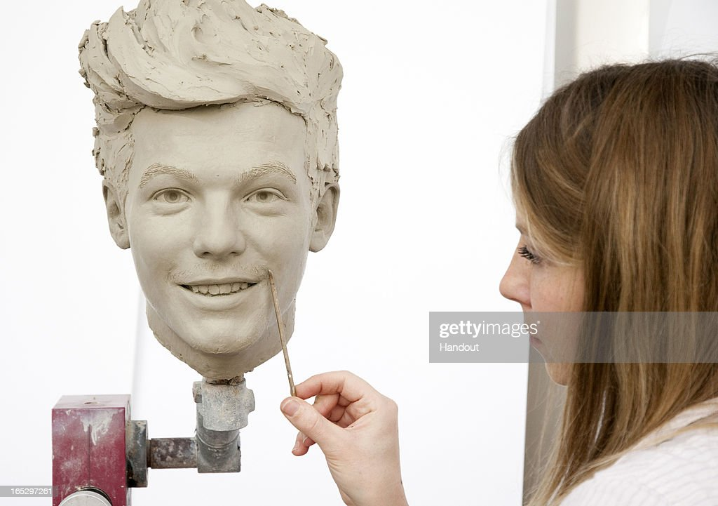 In this handout image provided by Madame Tussauds, sculptor Georgina Power works on the clay head of Louis Tomlinson of One Direction. Madame Tussauds announced on March 11, 2013 that the world famous wax attraction will immortalize the band by creating five individual wax figures of each member. The figures are being created in full cooperation with the band and will be part of a traveling exhibit that will launch in London on April 18 before traveling to New York, July 19 - October 11, and Sydney, October 24 - January 28.