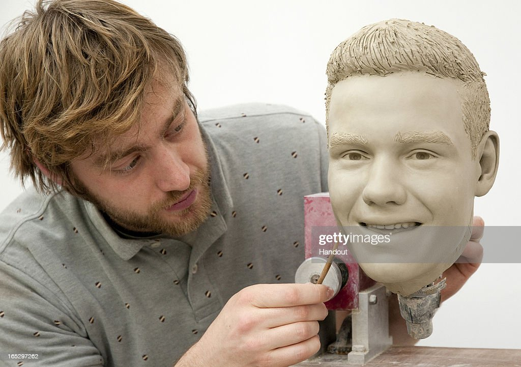 In this handout image provided by Madame Tussauds, sculptor Alex Carlisle works on the clay head of Liam Payne of One Direction. Madame Tussauds announced on March 11, 2013 that the world famous wax attraction will immortalize the band by creating five individual wax figures of each member. The figures are being created in full cooperation with the band and will be part of a traveling exhibit that will launch in London on April 18 before traveling to New York, July 19 - October 11, and Sydney, October 24 - January 28.