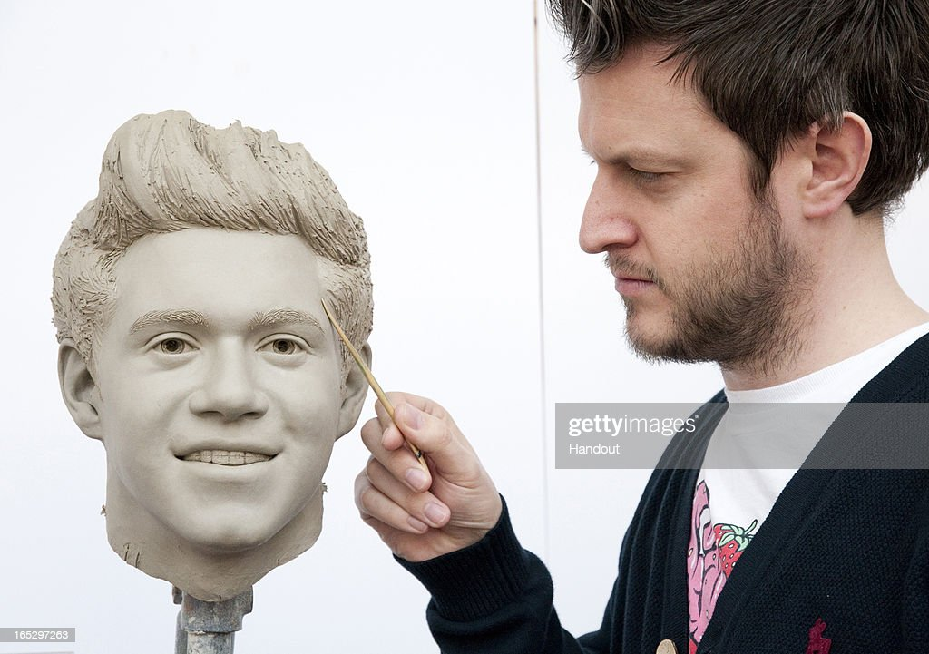 In this handout image provided by Madame Tussauds, sculptor Dave Burks works on the clay head of Niall Horan of One Direction. Madame Tussauds announced on March 11, 2013 that the world famous wax attraction will immortalize the band by creating five individual wax figures of each member. The figures are being created in full cooperation with the band and will be part of a traveling exhibit that will launch in London on April 18 before traveling to New York, July 19 - October 11, and Sydney, October 24 - January 28.