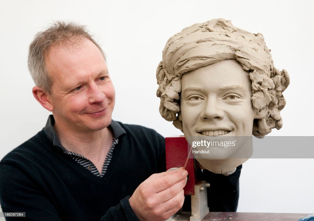 In this handout image provided by Madame Tussauds, sculptor Jim Kemp works on the clay head of Harry Styles of One Direction. Madame Tussauds announced on March 11, 2013 that the world famous wax attraction will immortalize the band by creating five individual wax figures of each member. The figures are being created in full cooperation with the band and will be part of a traveling exhibit that will launch in London on April 18 before traveling to New York, July 19 - October 11, and Sydney, October 24 - January 28.