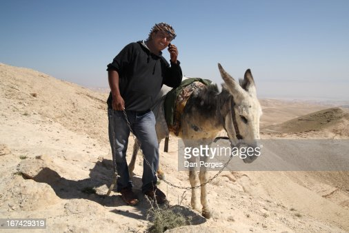 DIGITAL NOMAD AND HIS ASS : Stock Photo