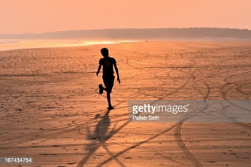 SEA.....SAND......SUNSET.....SHADOW : Stock Photo