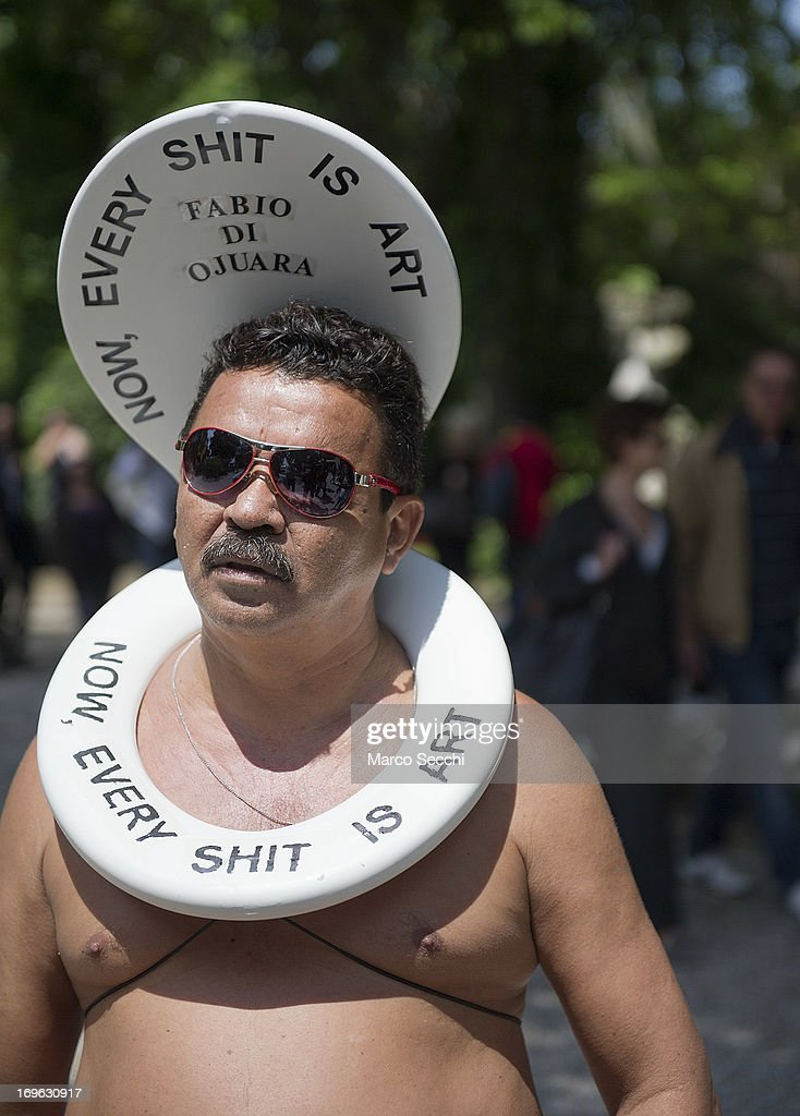 An artist wearing a toilet seat walks outside the 55th International Art Exhibition during the press preview days, on May 29 2013 in Venice, Italy. The 55th International Art Exhibition of La Biennale di Venezia will be open to the public from the June 1 - November 24, 2013.
