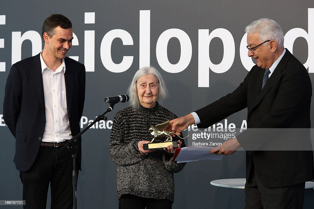 President of Biennale Paolo Baratta and Massimiliano Gioni deliver the Golden Lion Lifetime Achievement to Marisa Merz during The 55th International Art Exhibition at Giardini on June 1, 2013 in Venice, Italy. The 55th International Art Exhibition of La Biennale di Venezia will be open to the public from June 1 - November 24, 2013.