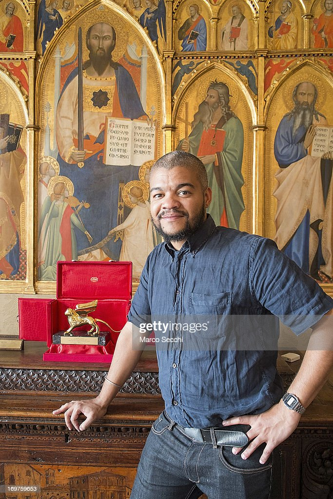 Edson Chagas of Angola, winner of the Golden Lion for Best National Participation, poses next to his award during the 55th International Art Exhibition of La Biennale di Venezia on June 1, 2013 in Venice, Italy. The 55th International Art Exhibition of La Biennale di Venezia will be open to the public from the June 1 - November 24, 2013.